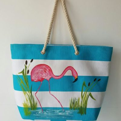 sac turquoise flamant rose face